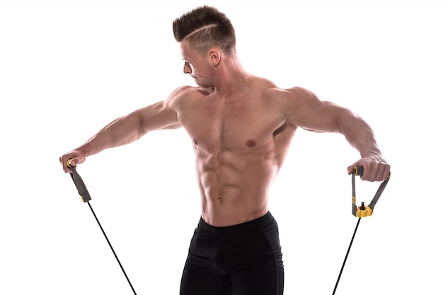 Bodybuilder working out with rubber band
