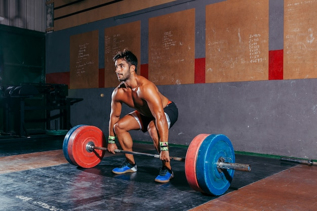 Bodybuilding concept with barbell