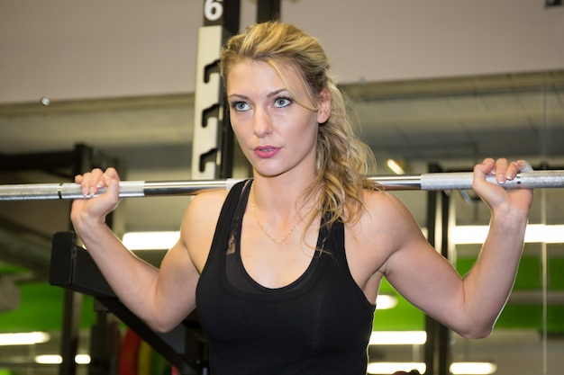 Bodybuilding. strong fit woman exercising with weights