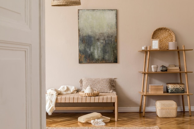 Boho composition of living room with design chaise longue, pillows, baskets, painting, rattan natural decorations and elegant personal accessories. oriental concpet of cosy home decor.