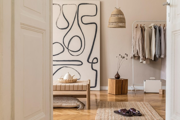 Boho composition of living room with furnitures, mock up painting, rattan decoration and elegant personal accessories. beige wall. home decor. template.