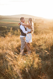 Boho style couple in the field