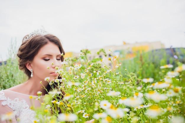 Boho styled bride on nature background daisy bouquet.