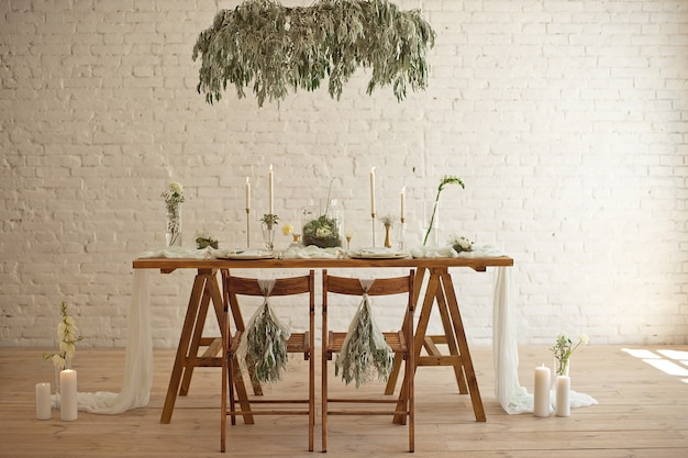 Boho wedding table setting, rustic decorations, gold and blue details, wooden table.luxury wedding decor.