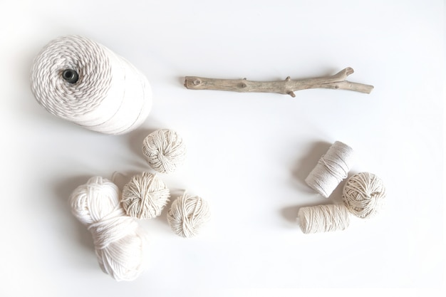 Boho white mockup with cotton yarn on the desk. top view flat lay. space for your text