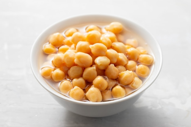 Boiled chick pea in white bowl
