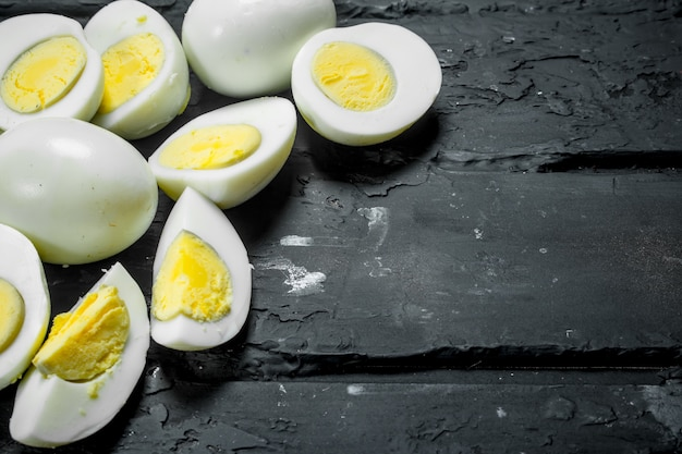 Boiled chicken eggs. on a black rustic background.