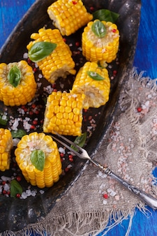 Boiled corn pieces with basil. snack on summer parties.