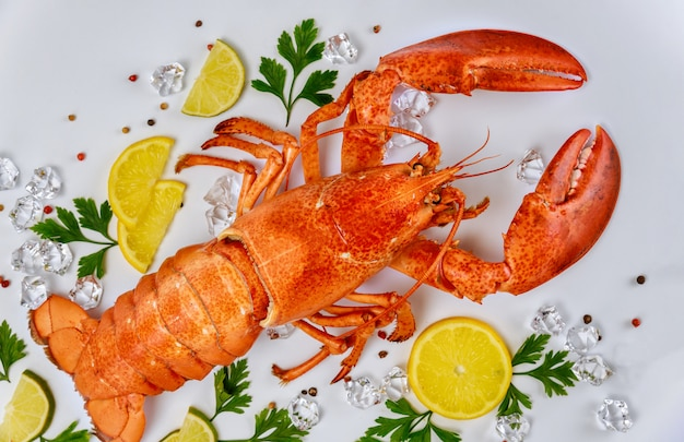 Boiled crab with lemon, parsley and black pepper on white