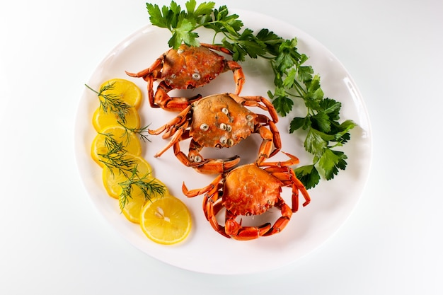 Boiled crabs with lemon and parsley