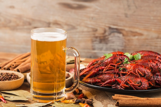 Boiled crayfish with beer on wooden