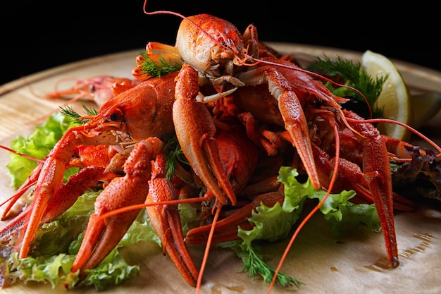 Boiled crayfish on a wooden board