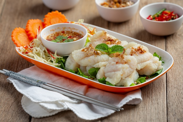 Boiled dolly fish with spicy seafood sauce.