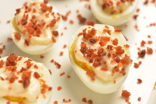 Boiled egg with bacon and mayonaise