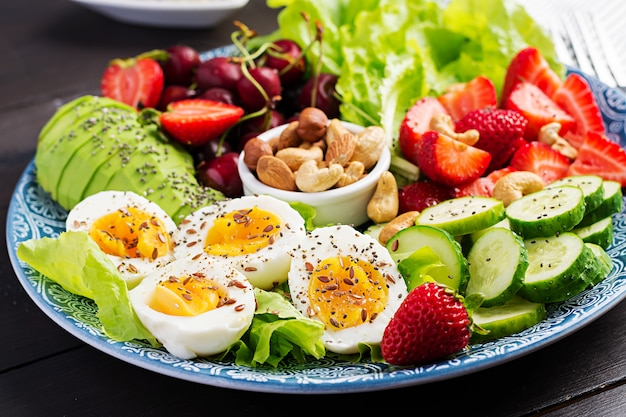 Boiled eggs, avocado, cucumber, nuts, cherry and strawberries