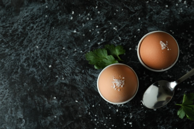 Boiled eggs on black smokey table