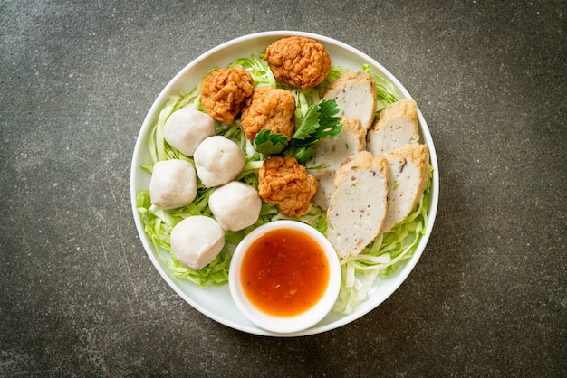 Boiled fish balls, shrimp balls and chinese fish sausage with spicy dipping sauce