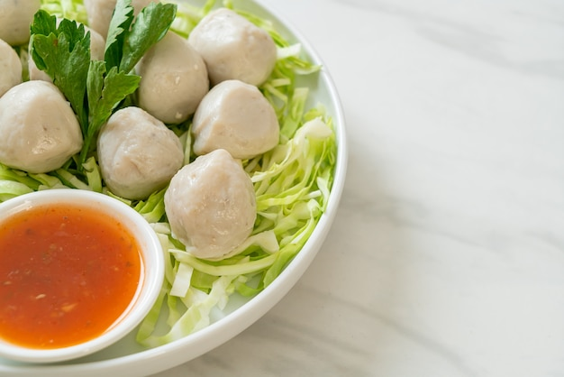 Boiled fish balls with spicy dipping sauce