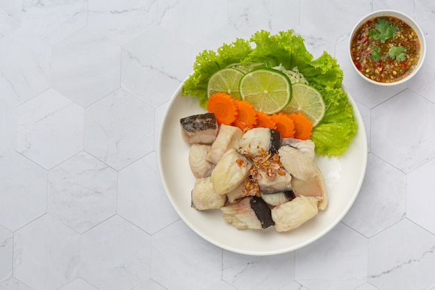 Boiled fish with spicy dipping sauce and vegetable