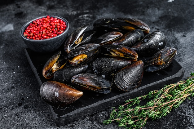 Boiled mussels in shells on a marble board