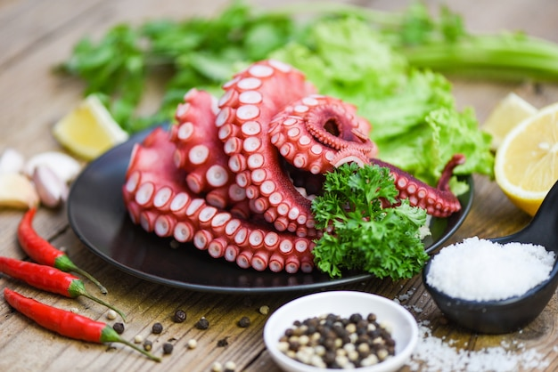 Boiled octopus tentacles with lemon on plate, octopus food cooked salad seafood squid cuttlefish