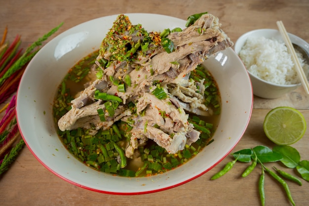 Boiled pork bone soup with spicy flavor. belicious sour spicy pork spare rib soup. tom zap