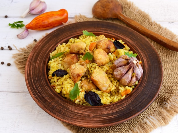Boiled rice with roasted chicken, carrots, spices (traditional asian dish - pilaf)