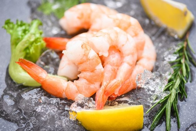 Boiled shrimps prawns on ice frozen