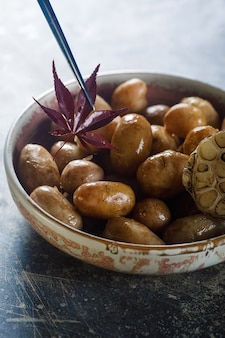 Boiled young potatoes with oil and roasted garlic, in a wooden dish