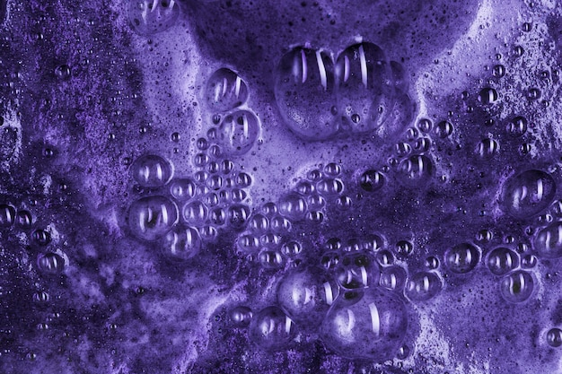 Boiling purple liquid with foam and blobs