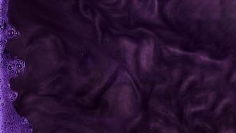 Boiling purple stiff paint with foam