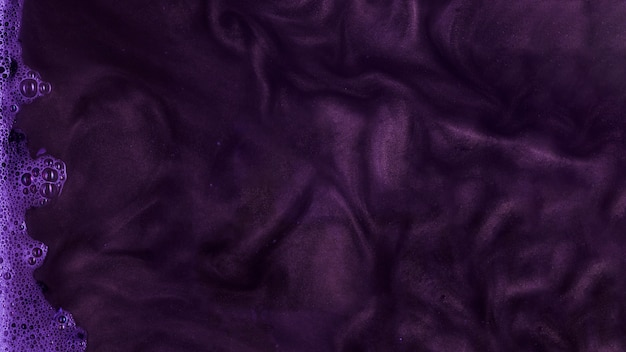 Boiling purple stiff paint with foam