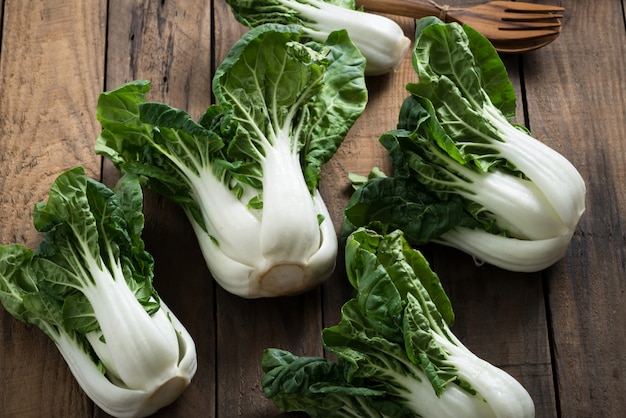 Bok choy or mini bok choy, chinese asian vegetables on wood