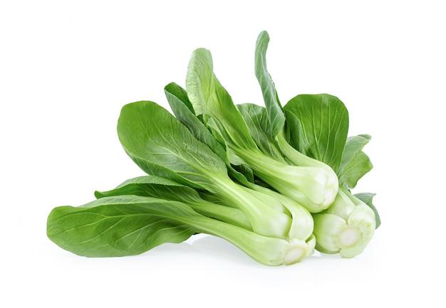 白い壁に青菜野菜。
