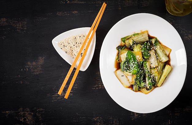 Bok choy vegetables stir fry with soy sauce and sesame seeds
