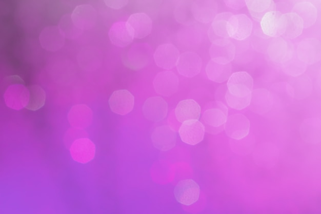 Bokeh abstract texture. beautiful christmas background in purple colors. defocused