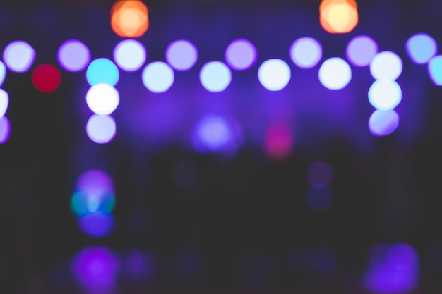 The bokeh background of the beautiful stage lights at night.