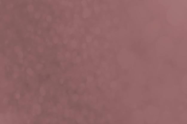 어두운 먼지가 많은 분홍색의 bokeh 배경