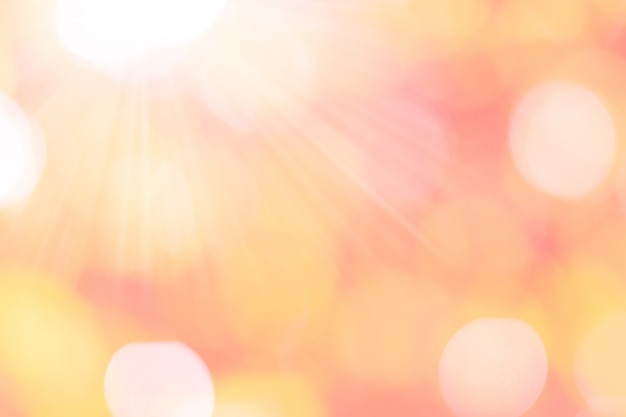 Bokeh background with pink, orange sunlight to be used as a valentine or love period.