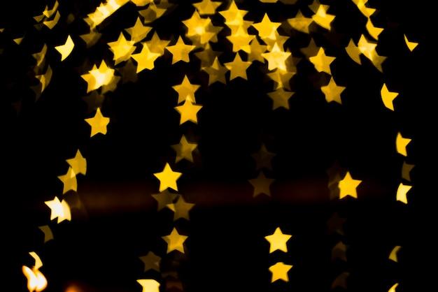 Bokeh фон с желтыми огнями в форме звезды