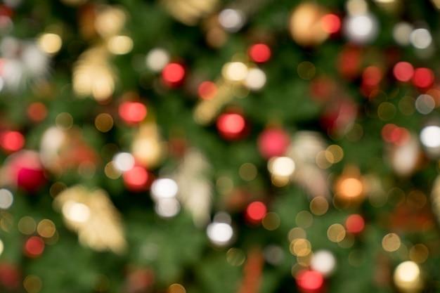 クリスマスの壁紙と背景としてのbokehクリスマスツリー