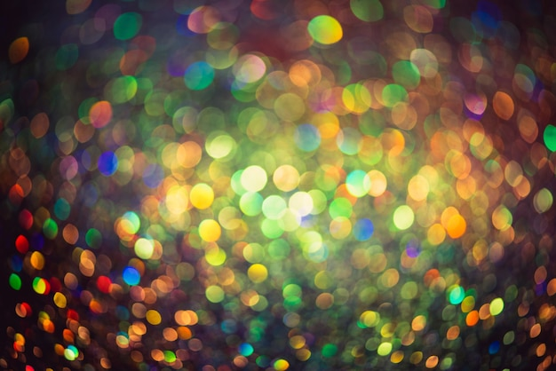 Bokeh effect glitter colorful blurred abstract background for birthday, anniversary, wedding, new year eve or christmas.
