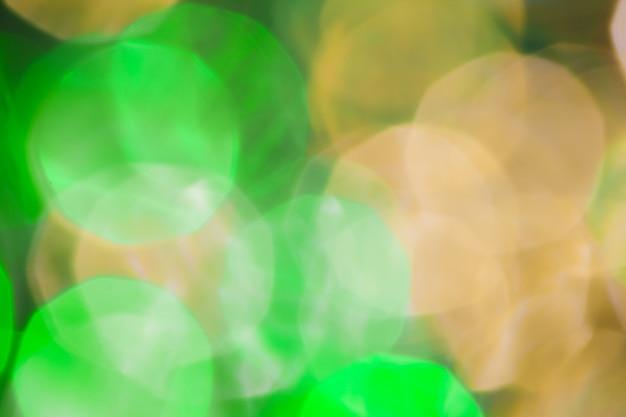Bokeh of green garland lighting elements background