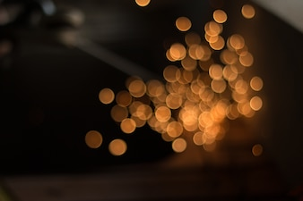 Bokeh light from sparks, labour welding steel in the industry plants.