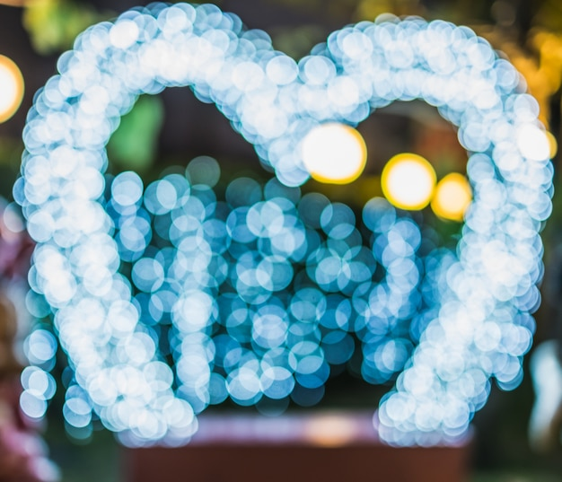 Bokeh lights frame photo booth with heart shape