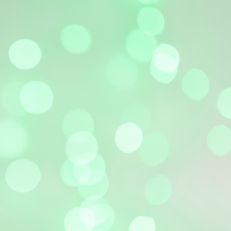 Bokeh lights on green background