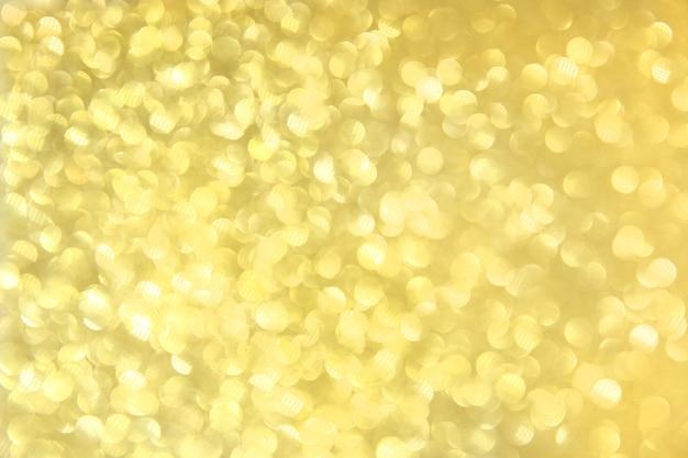 ゴールドの背景にボケ味、きらめくベージュの背景、焦点の合っていない金色の光、選択されたシャープネス