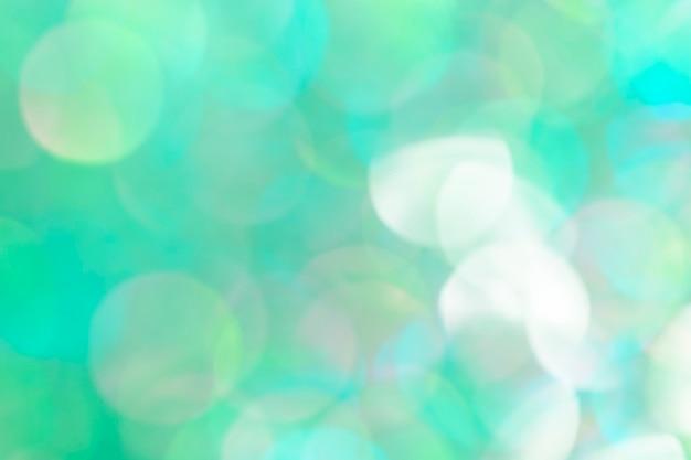 Bokeh pattern on a bluish green background