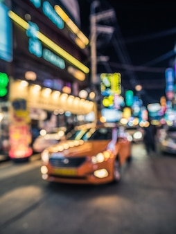 Bokeh shot on the street with taxi in front