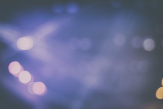 Боке обои. disfocus или размытый фон сценического освещения в винтажном цвете. фон для бизнеса - концертная концепция.